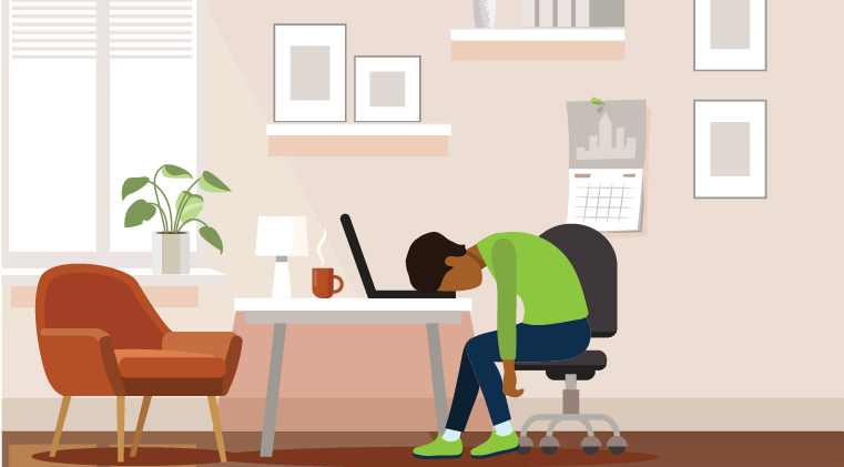 Exhausted employee sitting at desk